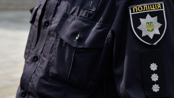 Ukrajinský policista v Kyjevě - Sputnik Česká republika
