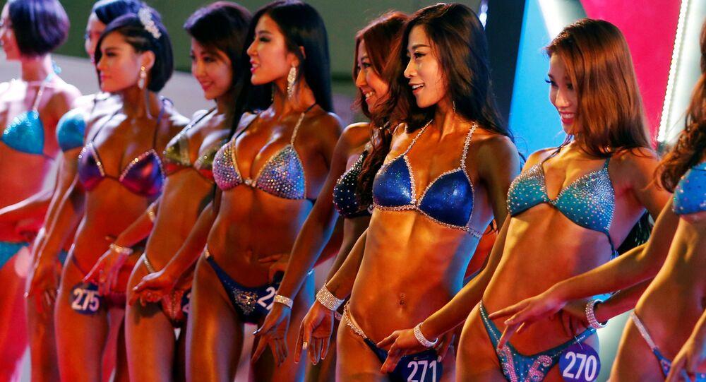 Sportovkyně na soutěži v bodybuildingu v Pekingu