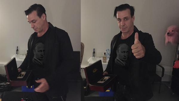 Till Lindemann se zlatým iPhonem - Sputnik Česká republika