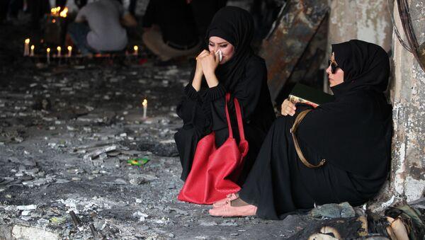 Irácké ženy pláčou u místa výbuchu v Bagdádu - Sputnik Česká republika