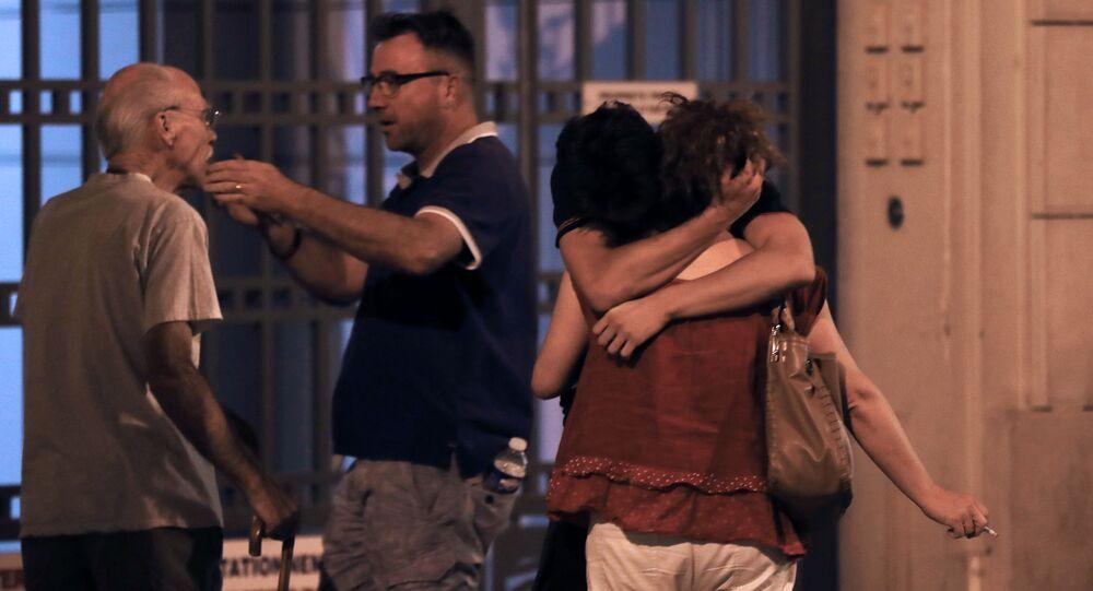 Lidé na nábřeží des Anglais v Nice