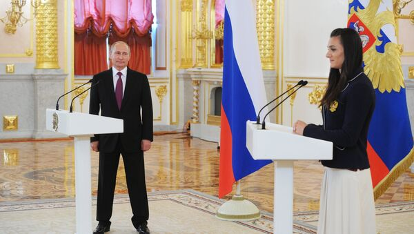 Ruský prezident Vladimir Putin během setkání s ruskou reprezentací - Sputnik Česká republika