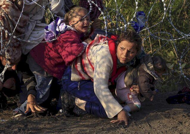 Syrští uprchlíci na srbsko-maďarské hranici