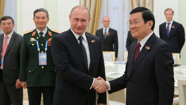 Ruský prezident Vladimir Putin a vietnamský prezident Trương Tấn Sang - Sputnik Česká republika