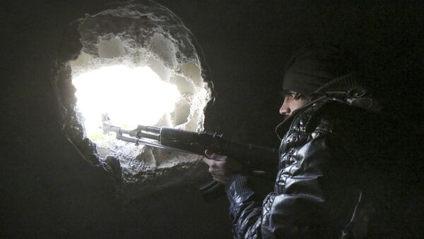 Příslušník syrské opozice na severozápadě Aleppa - Sputnik Česká republika