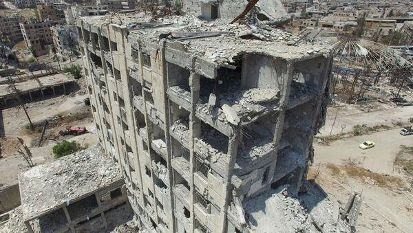 Budova v Aleppu - Sputnik Česká republika