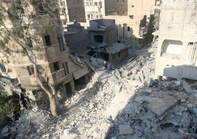Zničené budovy v Aleppu, Sýrie