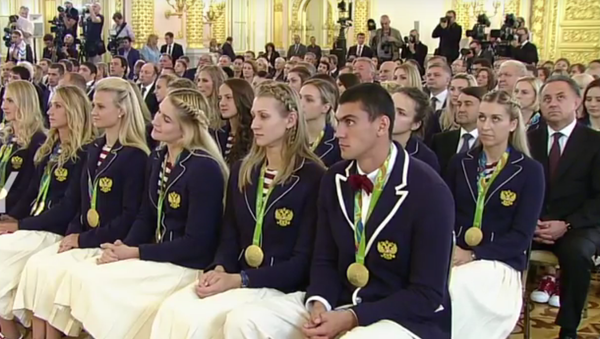 Vladimir Putin odměňuje ruské sportovce v Kremlu - Sputnik Česká republika