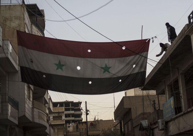 Syrská vlajka v Kámišlí