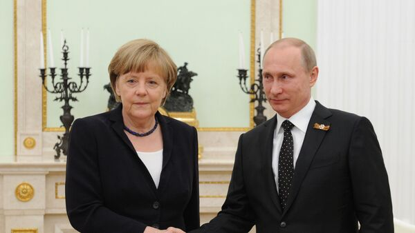 Vladimir Putin a Angela Merkelová - Sputnik Česká republika