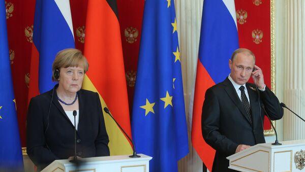 Angela Merkelová a Vladimír Putin. - Sputnik Česká republika