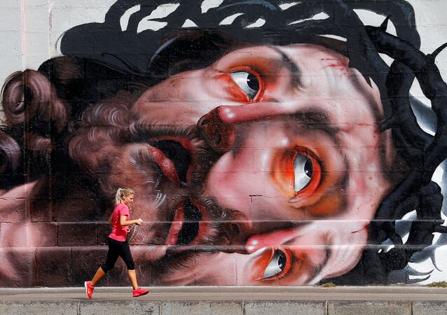 Běžkyně na nábřeží ve Vídni. Ilustrační foto