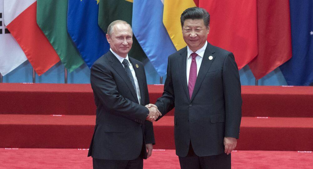 Vladimir Putin a Si Ťin-pching během summitu G20