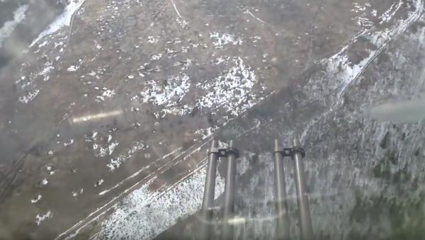 Letoun Il-76 střílí ze zadních kanónů - Sputnik Česká republika