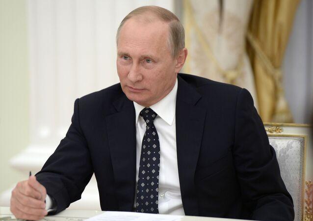 Ruský prezident Vladimir Putin během setkání s učiteli v Kremlu