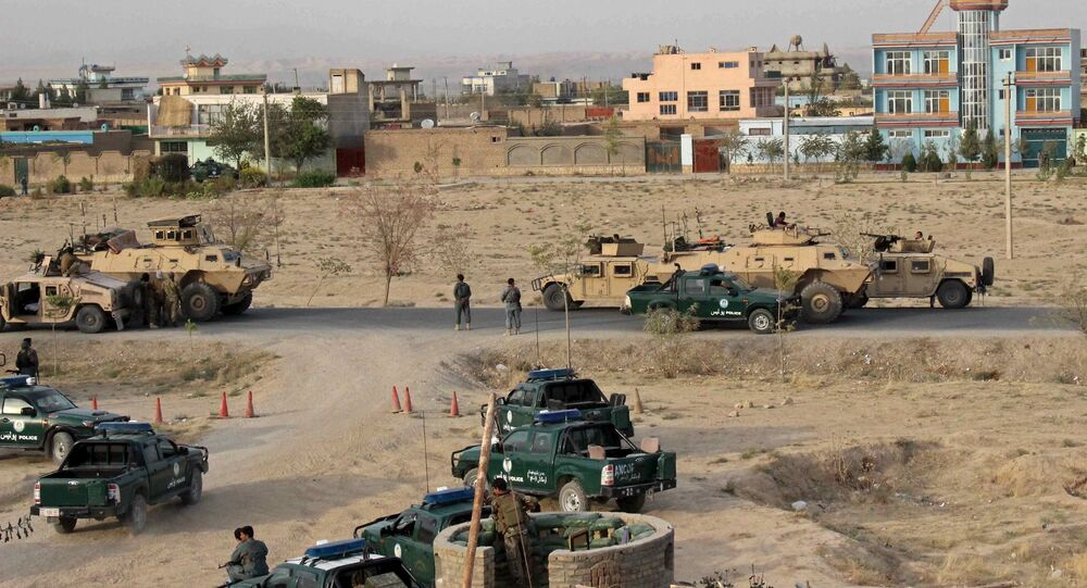 Afghan security forces take their positions during a gun battle in Kunduz city, northern Afghanistan September 29, 2015