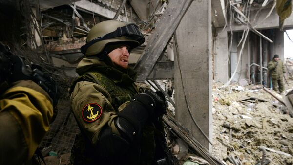 Self-defense fighter known by his nickname of Motorola stands inside a destroyed airport building in the eastern Ukrainian city of Donetsk, on February 26, 2015 - Sputnik Česká republika