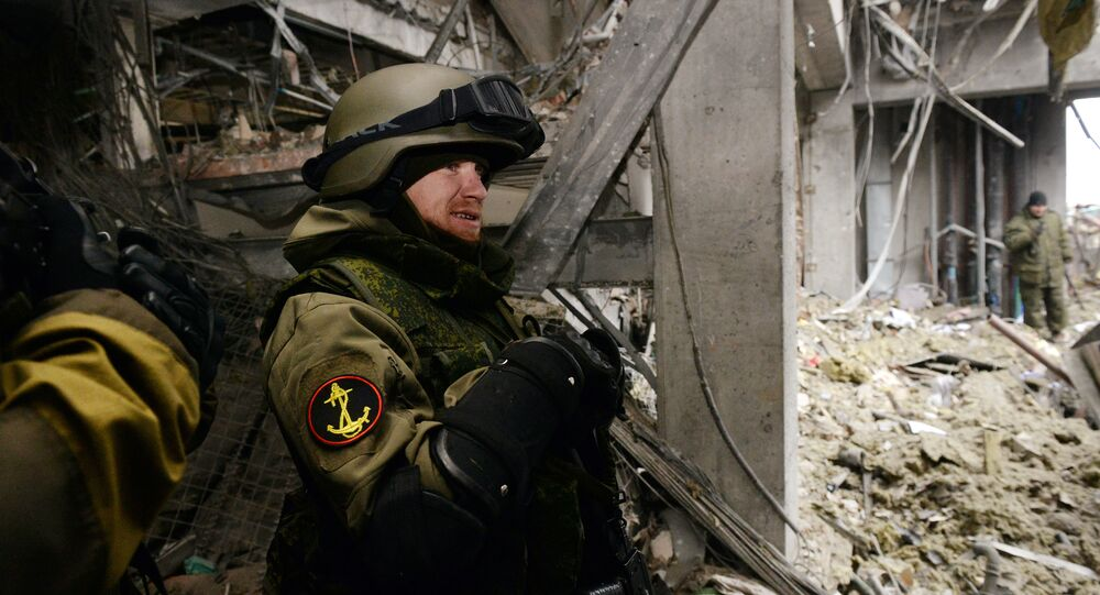 Self-defense fighter known by his nickname of Motorola stands inside a destroyed airport building in the eastern Ukrainian city of Donetsk, on February 26, 2015