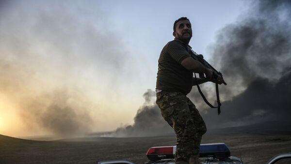 Irácký voják během operace - Sputnik Česká republika