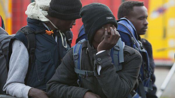 Migranti v táboru Calais - Sputnik Česká republika
