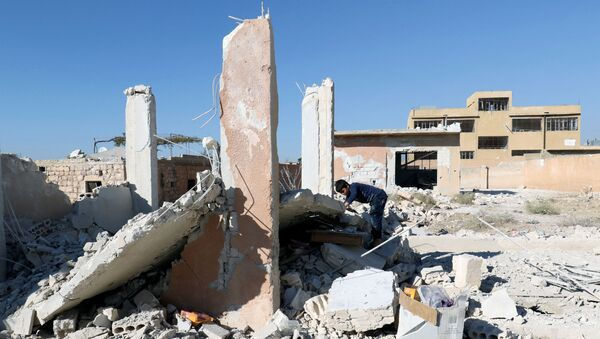 Zničení kvůli leteckému útoku v Idlibě - Sputnik Česká republika