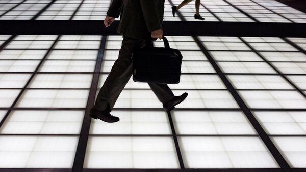 Muž jde do práce v Tokiu - Sputnik Česká republika