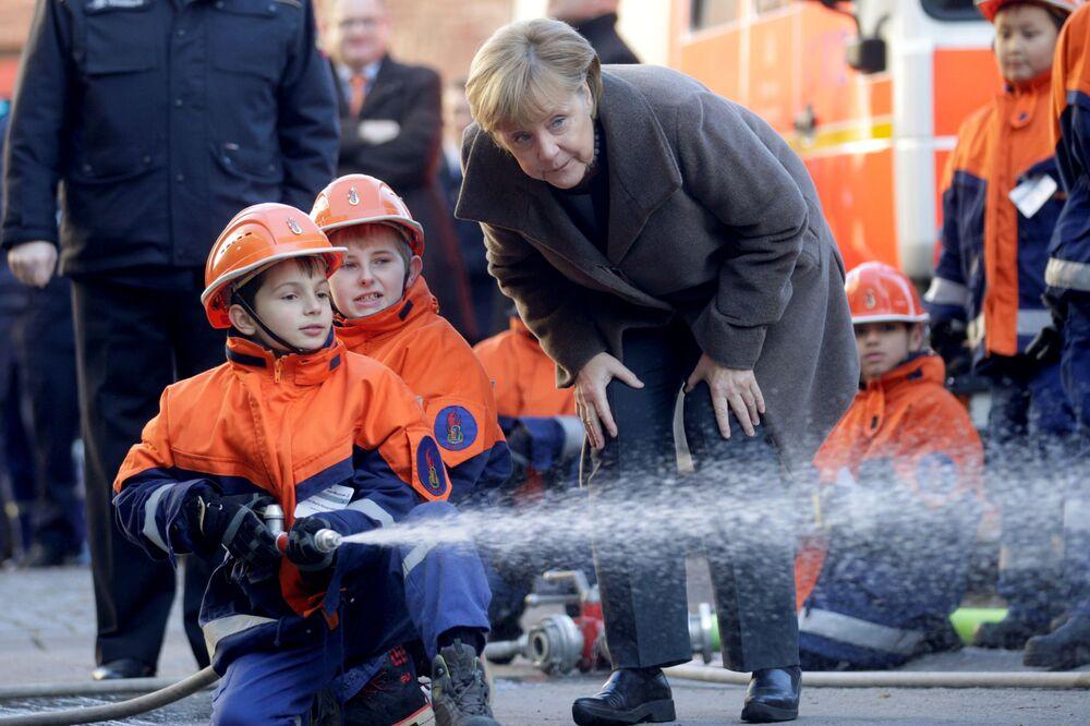 Německé kancléřka Merkelová s dětmi