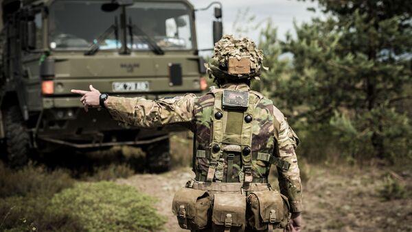 Britský voják na cvičeních v Lotyšsku - Sputnik Česká republika