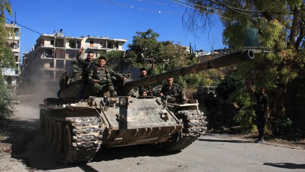 Syrští vojáci na T-55 ve východní části Aleppa, září 2016 - Sputnik Česká republika