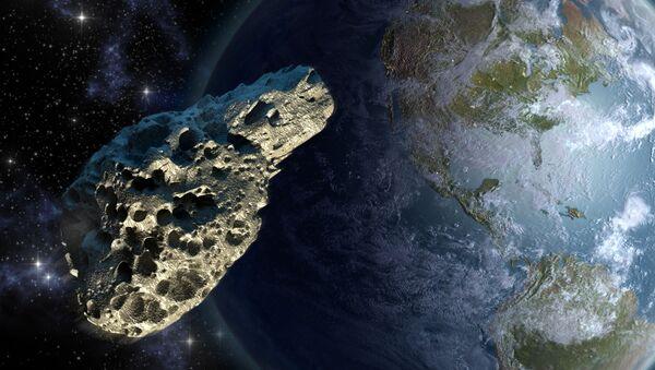 Asteroid na pozadí Země - Sputnik Česká republika