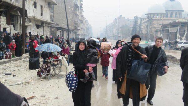 Obyvatelé východního Aleppa - Sputnik Česká republika