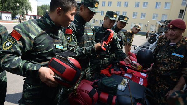 Společné cvičení ruské Národní gardy a čínské armády. Ilustrační foto - Sputnik Česká republika