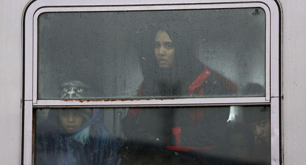 Uprchlíci na slovinském vlaku