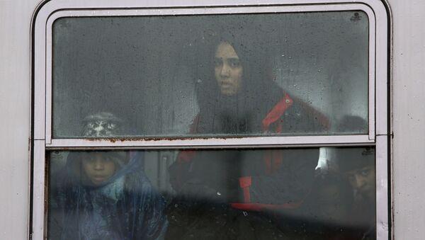 Uprchlíci na slovinském vlaku - Sputnik Česká republika