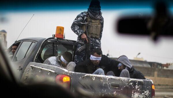 Ozbrojenci IS, kteří byli zatčení v Mosulu - Sputnik Česká republika
