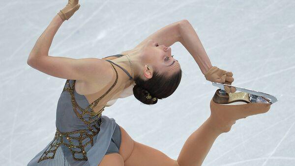 Angelina Sotnikova durante a sua apresentação nas Olimpíadas 2014 em Sochi - Sputnik Česká republika