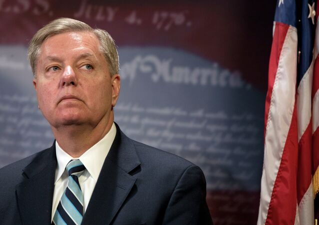 Lindsey Graham listens during a news conference