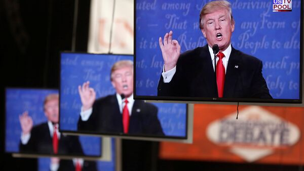 Donald Trump is shown on TV monitors in the media filing room on the campus of University of Nevada, Las Vegas, during the last 2016 U.S. presidential debate in Las Vegas, US, October 19, 2016. - Sputnik Česká republika