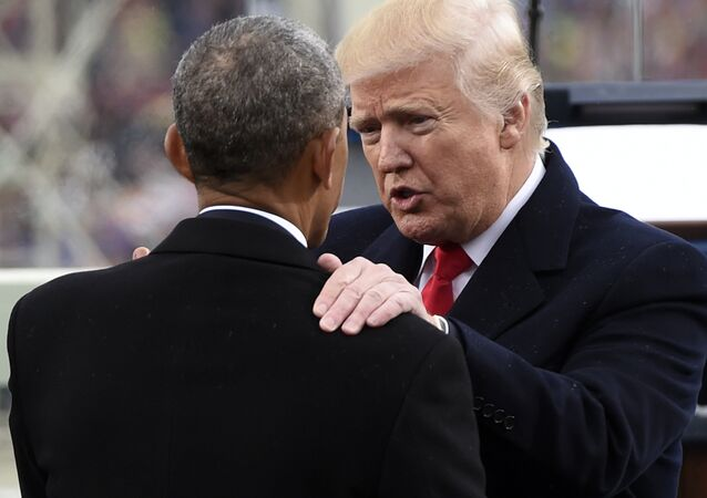 President Donald Trump talks with former President Barack Obama on Capitol Hill in Washington, Friday, Jan. 20, 2017, after Trump took the presidential oath