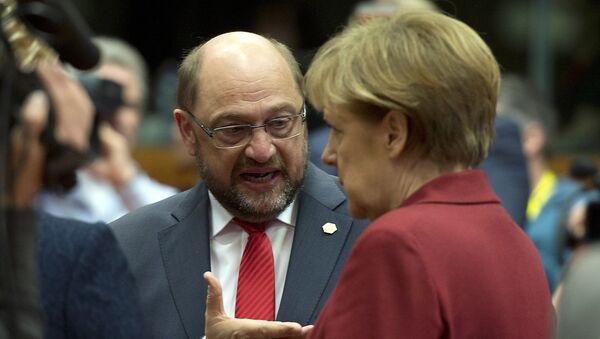 Martin Schulz a Angela Merkelová - Sputnik Česká republika