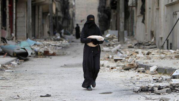 Žena v Aleppu - Sputnik Česká republika
