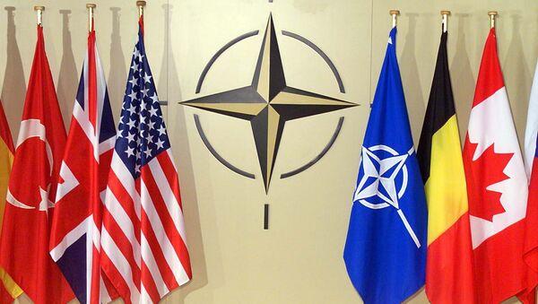 Vlajky v hlavním stanu NATO v Bruselu - Sputnik Česká republika