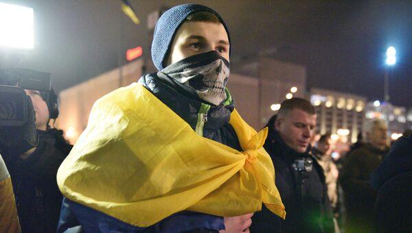 Účastnik třetího výročí majdanu v Kyjevě. Ilustrační foto - Sputnik Česká republika