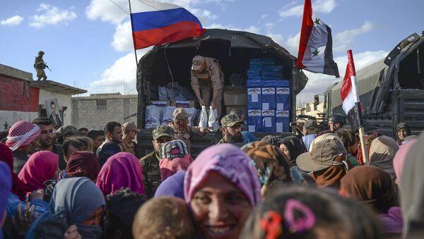 Humanitární pomoc  Syřanům - Sputnik Česká republika
