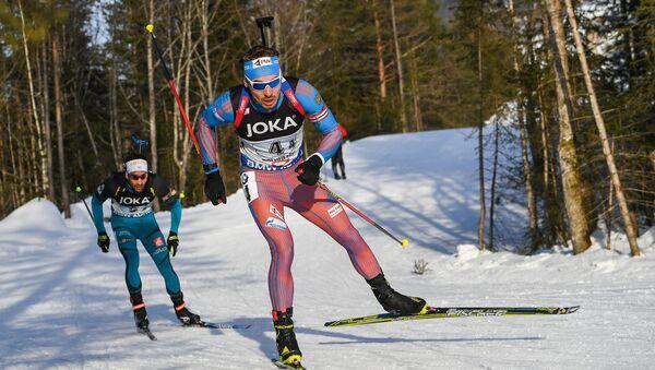Biatlonisté Anton Šipulin a Martin Fourcade - Sputnik Česká republika