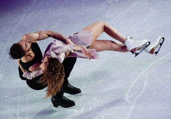 Gabriela Papadakis a Guillaume Cizeron, kteří obsadili druhé místo v tancích na MS v krasobruslení v Helsinkách - Sputnik Česká republika