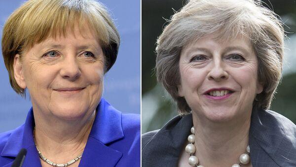 Britská premiérka Theresa Mayová a německá kancléřka Angela Merkelová - Sputnik Česká republika