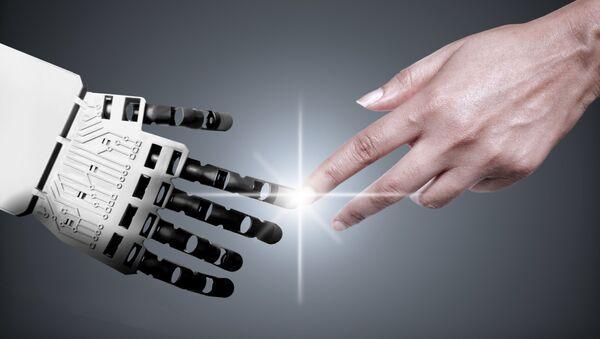 Ruce robota a člověka. Ilustrační foto - Sputnik Česká republika