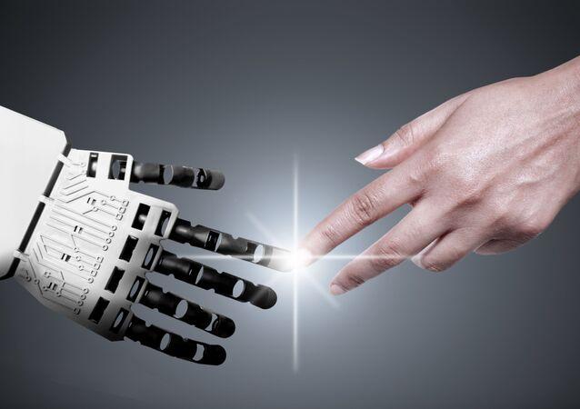 Ruce robota a člověka. Ilustrační foto