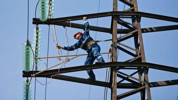 Oprava elektrického vedení. Ilustrační foto - Sputnik Česká republika